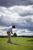 Golf player pitching. The golf ball, ball in the air Stock Images