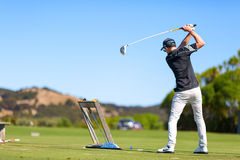 Golf player is practicing on the golf field. Cape Kidnappers golf court. New Zealand. Royalty Free Stock Photo