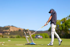 Golf player is practicing on the golf field. Cape Kidnappers golf court. New Zealand. Royalty Free Stock Photography