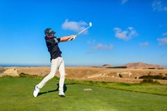 Golf player is practicing on the golf field. Cape Kidnappers golf court. New Zealand. Stock Photo