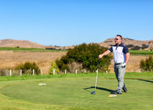 Golf player is practicing on the golf field. Cape Kidnappers golf court. New Zealand.