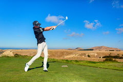 Golf player is practicing on the golf field. Cape Kidnappers golf court. New Zealand. Stock Images