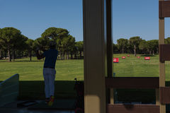 Golf player practicing shot on training Royalty Free Stock Photo