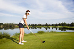 Golf player preparing for teeing off. Stock Images