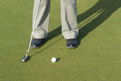 Golf player. During putt golf ball Stock Images