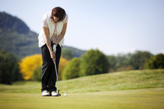 Golf Player Putting Ball. Stock Images
