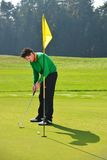 Golf player putting Stock Photography