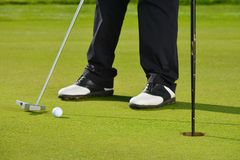 Golf player putting royalty free stock photo