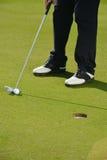 Golf player putting Stock Photos