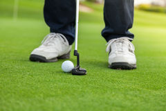 Golf player at the putting green Royalty Free Stock Photos