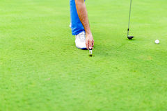Golf player repairing divot Stock Images
