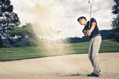 Golf player in sand trap. Stock Photos