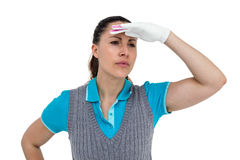 Golf player with shielding eyes Stock Image