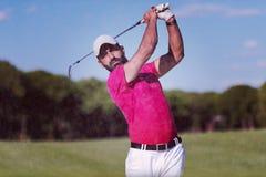 Golfer hitting a sand bunker shot. Golf player shot ball from sand bunker at course Stock Photos