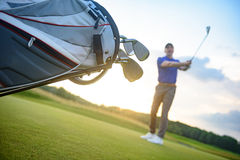 Golf player shoting ball from course stock image