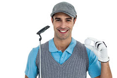 Golf player showing golf ball and holding golf club Stock Photos