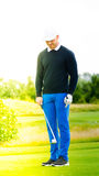 Golf player showing off skills Stock Images