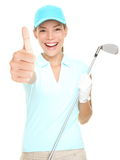 Golf player success woman smiling. Giving thumbs up hand sign holding golf club isolated on white background. Young mixed race Asian Caucasian female golf Stock Image