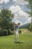 Golf player swing Stock Image