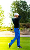 Golf player swinging to shoot Stock Photos