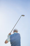 Golf player taking a shot Royalty Free Stock Photos