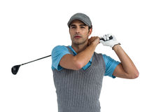 Golf player taking a shot Stock Photo