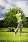 Golf player teeing off Stock Image
