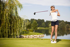 Golf player teeing off royalty free stock photo