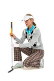 Golf player about to swing a golf ball Royalty Free Stock Images