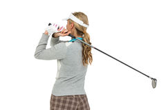 Golf player about to swing a golf ball. On white background Royalty Free Stock Photos