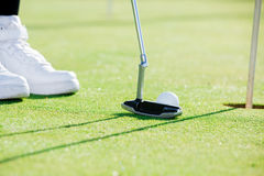 Golf player using golf club Stock Images