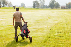 Golf player walking Stock Photos