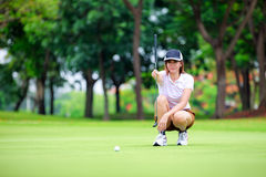 Golf Player With Putter Stock Photography