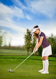 Golf player woman. Attractive golfer girl on golf course Stock Photo