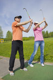 Golf players Stock Photos