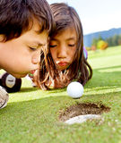 Golf players cheating Royalty Free Stock Photography