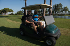 Golf players driving cart at course Stock Images