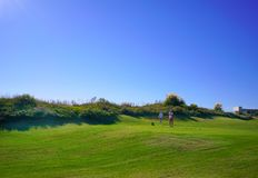Golf players are enjoying Likya Links Golf course at sunny day in  Antalya stock photography
