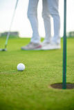 Golf players hitting shot with driver Royalty Free Stock Photo