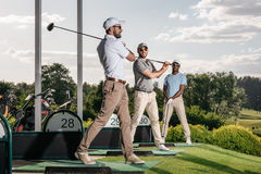 Golf players playing golf together at golf course Royalty Free Stock Photography
