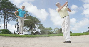 Golf players playing together. At golf course stock video