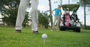 Golf players playing together stock video footage