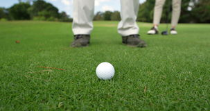 Golf players playing together stock footage