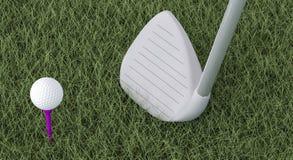 Golf - poner el mecanismo impulsor en la bola Fotografía de archivo