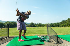 Golf Practice at the Driving Range Stock Photo