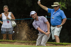 Golf Pro Grace Sand Shot. Action of  Branden Grace playing a sand trap shot at green side bunker Stock Photos