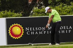 Golf Pro Lundberg Drivng klumpa ihop sig Arkivfoton