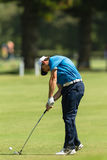 Golf Professional Tommy Fleetwood Swinging. Professional Tommy Fleetwood strikes golf ball at the European PGA Tournament Volvo Golf Champions Tournament action Royalty Free Stock Images