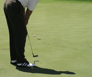 Golf putt. Image of golfer missing a put Royalty Free Stock Image