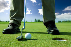 Golf Putt. A golf put into the hole Stock Photography